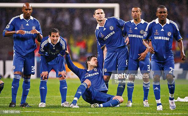 The Chelsea team Including German player Michael Ballack react as John Terry misses what would have been the winning penalty in the shootout against...