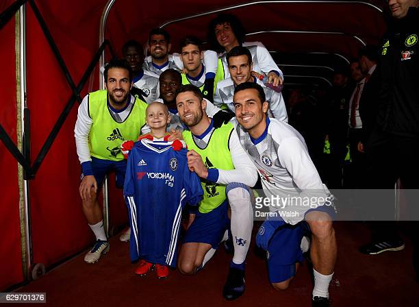 The Chelsea team pose for a photo with Sunderland fan Bradley Lowrey in the tunnel prior to kick off during the Premier League match between...