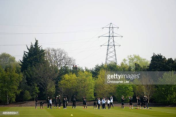 The Chelsea team warm up during the Chelsea Training Serssion at Chelsea Training Ground on April 21 2014 in Cobham England