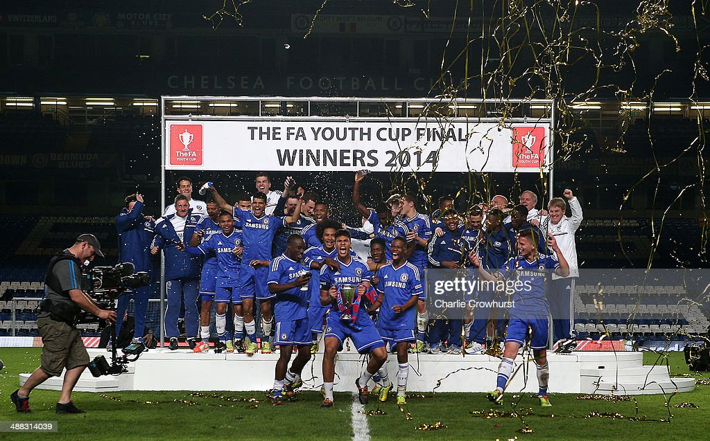 The Chelsea U18 team celebrate with the trophy after winning during the FA Youth Cup Final Second Leg match between Chelsea v Fulahm at Stamford...