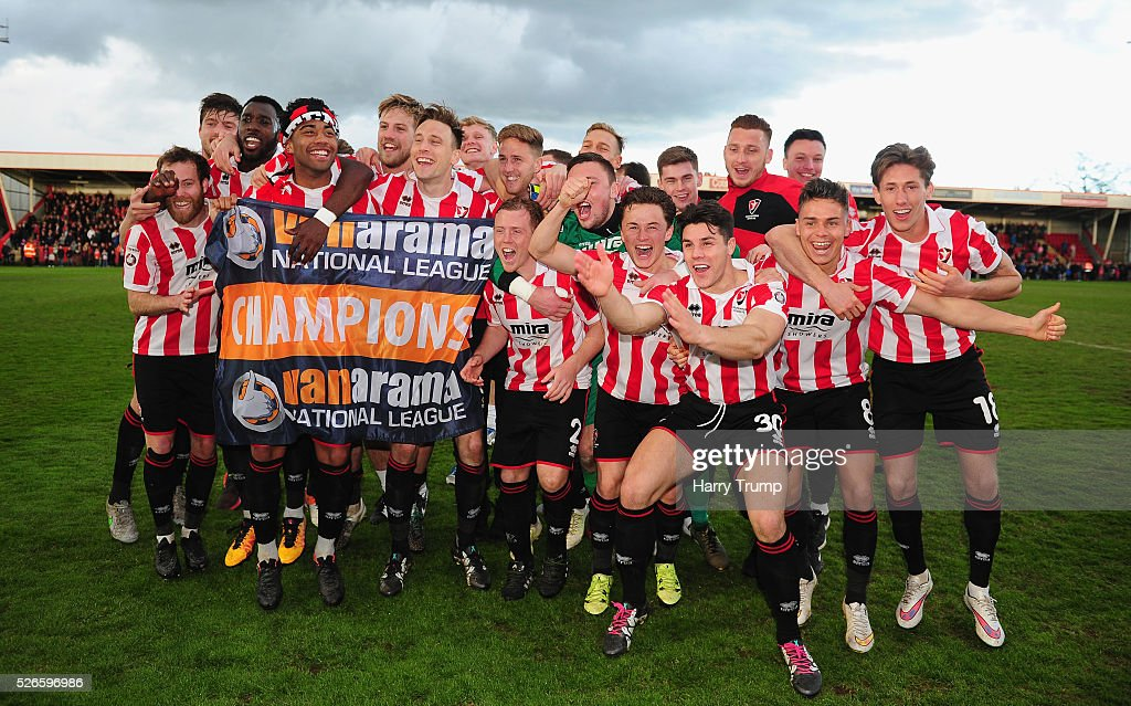 The Cheltenham Town side celebrate after being crowned Vanarama Conference Champions during the Vanarama Football Conference match between Cheltenham Town and Lincoln City at the World of Smile Stadium on April 30, 2016 in Cheltenham, England.