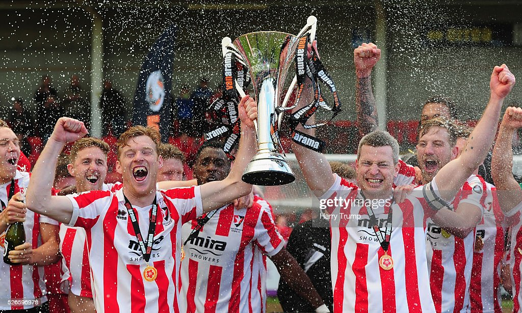 The Cheltenham Town side celebrate with the trophy after being crowned Champions of the Vanarama Conference during the Vanarama Football Conference match between Cheltenham Town and Lincoln City at the World of Smile Stadium on April 30, 2016 in Cheltenham, England.