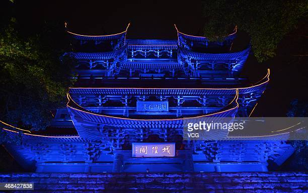 The Cheng Huang Pavilion is lit in blue lights to promote scientific knowledge and show care to autistic children on April 2 2015 in Hangzhou...
