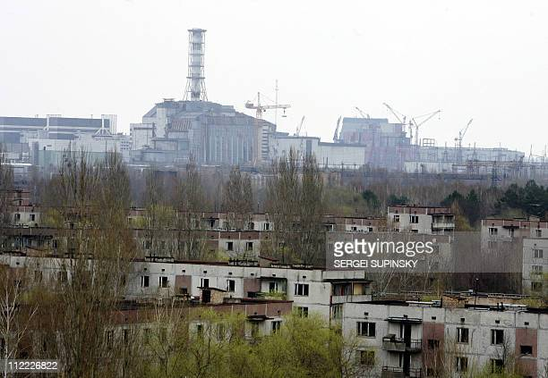 The Chernobyl nuclear power overlooks the ghost city of Pripyat 20 April 2006 Ukraine marks 26 April 2006 the 20th anniversary of an accident at the...