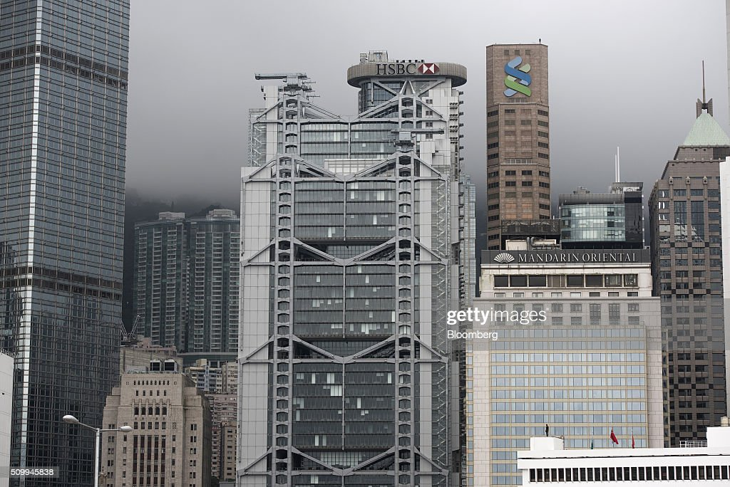 The Cheung Kong Center, from left, Bank of China Building, front, HSBC Holdings Plc headquarters, Standard Chartered Bank building, back, and the Mandarin Oriental hotel stand in Hong Kong, China, on Saturday, Feb. 13, 2016. HSBC's board will meet on Sunday to decide whether to shift its headquarters from London, according to two people with knowledge of the decision. Photographer: Xaume Olleros/Bloomberg via Getty Images