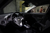 The Chevrolet logo is displayed on the steering wheel of a Cruze Eco at the General Motors headquarters April 1 2014 in Detroit Michigan General...