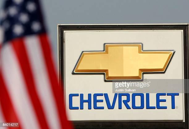 The Chevrolet logo is seen near an American flag at Santa Rosa Chevrolet December 12 2008 in Santa Rosa California Auto dealerships continue to see a...