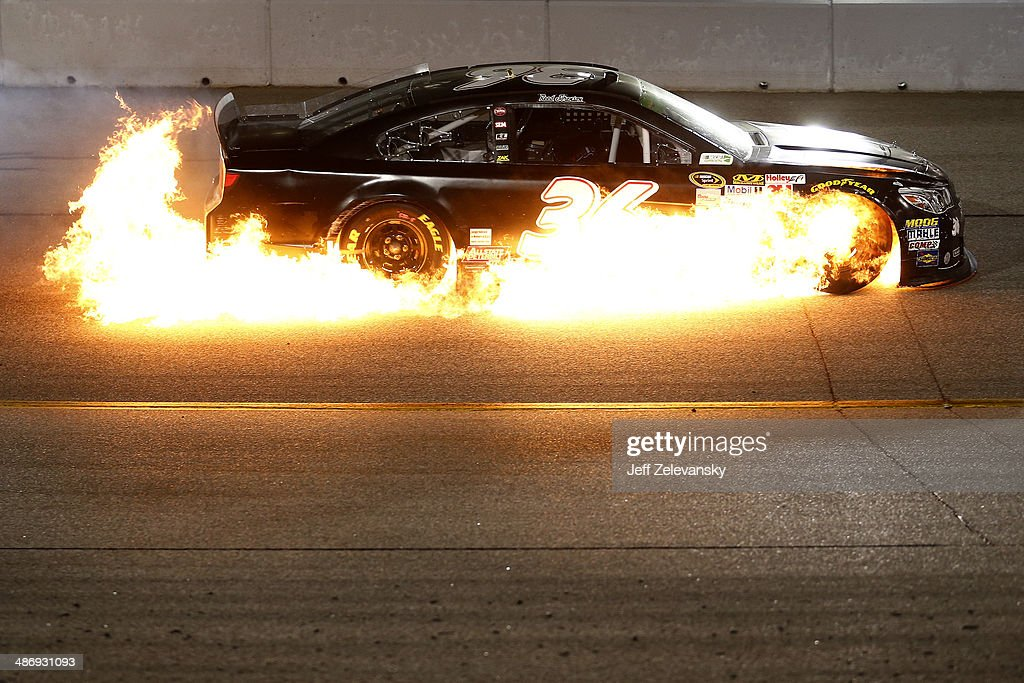 The #36 Chevrolet of Reed Sorenson catches fire during the NASCAR Sprint Cup Series Toyota Owners 400 at Richmond International Raceway on April 26, 2014 in Richmond, Virginia.