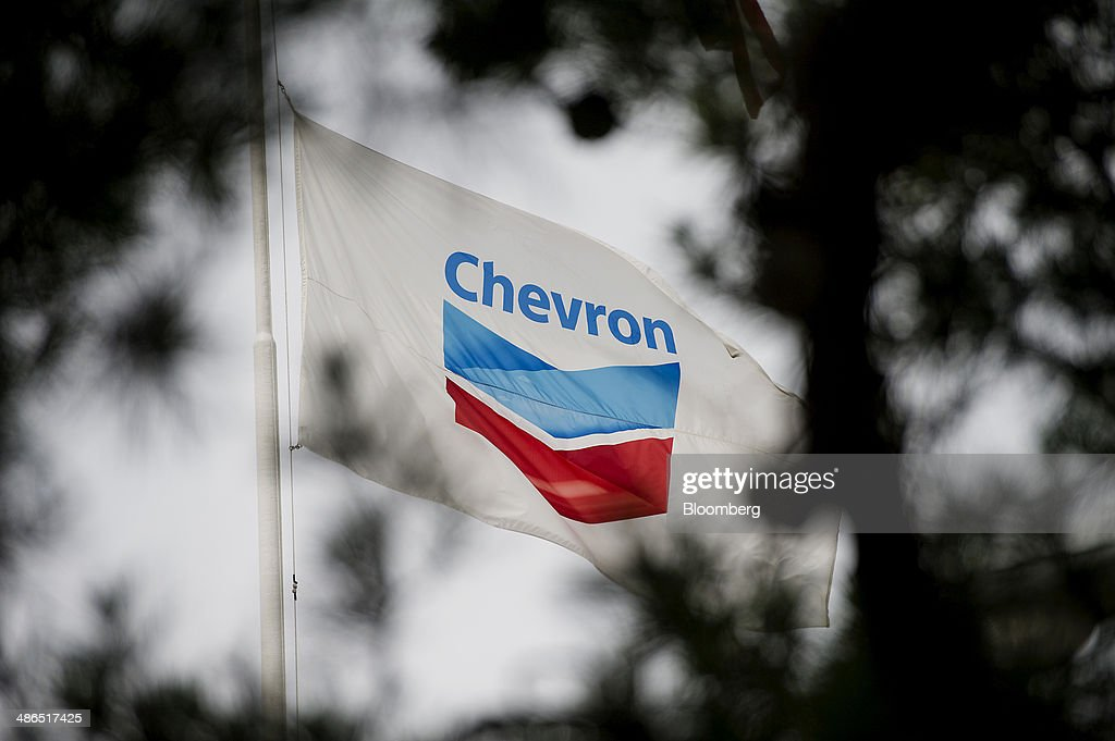 The Chevron Corp flag flies in front of the company's administrative building inside the Chevron Corp Richmond Refinery stands in Richmond California...