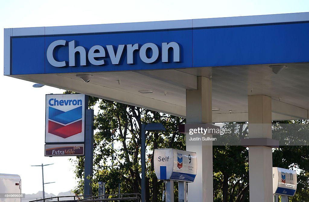 The Chevron logo is displayed at a Chevron station on October 30 2015 in Corte Madera California Chevron announced plans to cut up to 7000 jobs as...