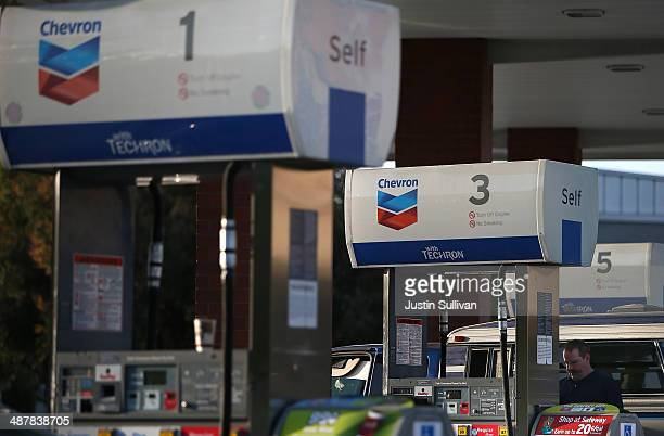 The Chevron logo is displayed on gas pumps at a Chevron gas station on May 2 2014 in Greenbrae California Chevron Corp reported a 27 percent plunge...