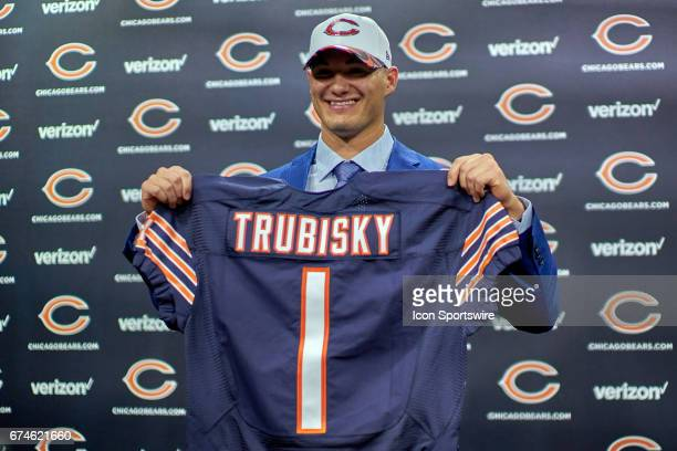 The Chicago Bears first round draft pick quarterback Mitchell Trubisky from North Carolina poses with a Bears jersey during a Chicago Bears Press...