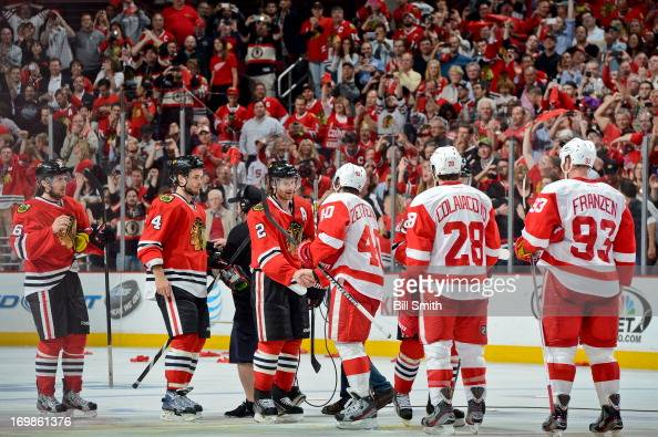 The Chicago Blackhawks and Detroit Red Wings shake hands after the Blackhawks defeated the Red Wings 21 to take the series in Game Seven of the...