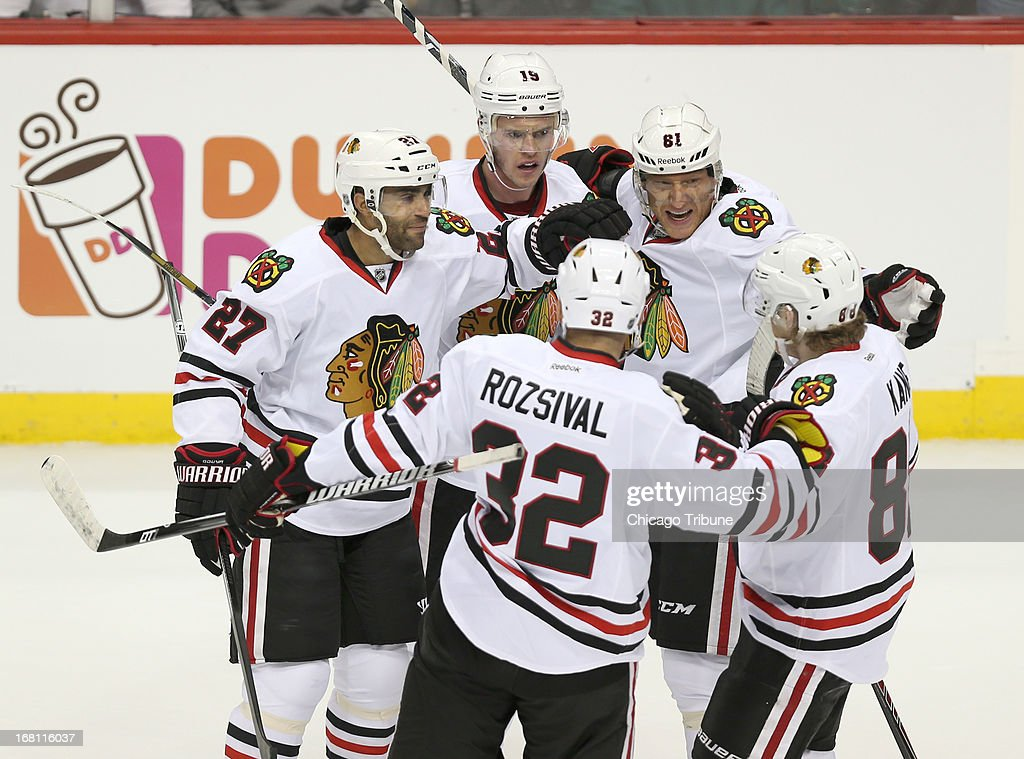 The Chicago Blackhawks celebrate a first-period goal by defenseman Johnny Oduya (27) against the Minnesota Wild during Game 3 of the NHL Western Conference playoffs at the Xcel Energy Center in St. Paul, Minnesota, Sunday, May 5, 2013.