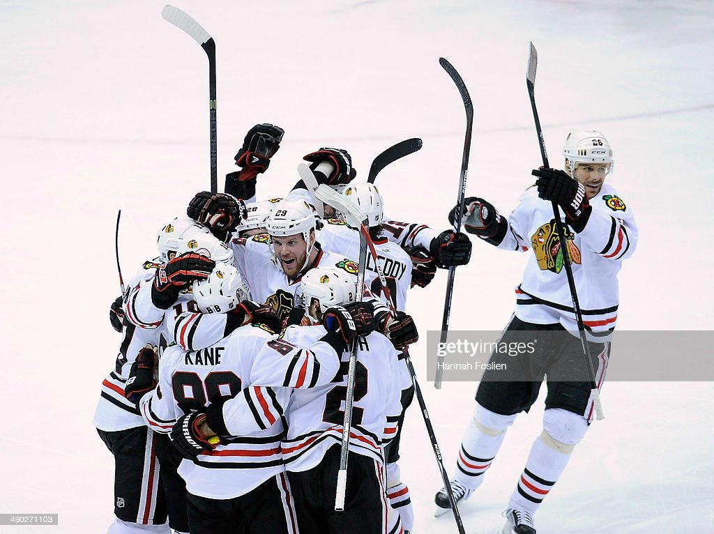 The Chicago Blackhawks celebrate a goal by Patrick Kane #88 against the Minnesota Wild during overtime in Game Six of the Second Round of the 2014 NHL Stanley Cup Playoffs on May 13, 2014 at Xcel Energy Center in St Paul, Minnesota. The Blackhawks defeated the Wild 2-1 in overtime.