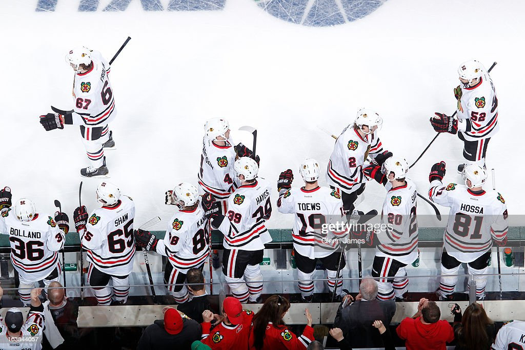 The Chicago Blackhawks celebrate a win against the Dallas Stars at the American Airlines Center on March 16, 2013 in Dallas, Texas.