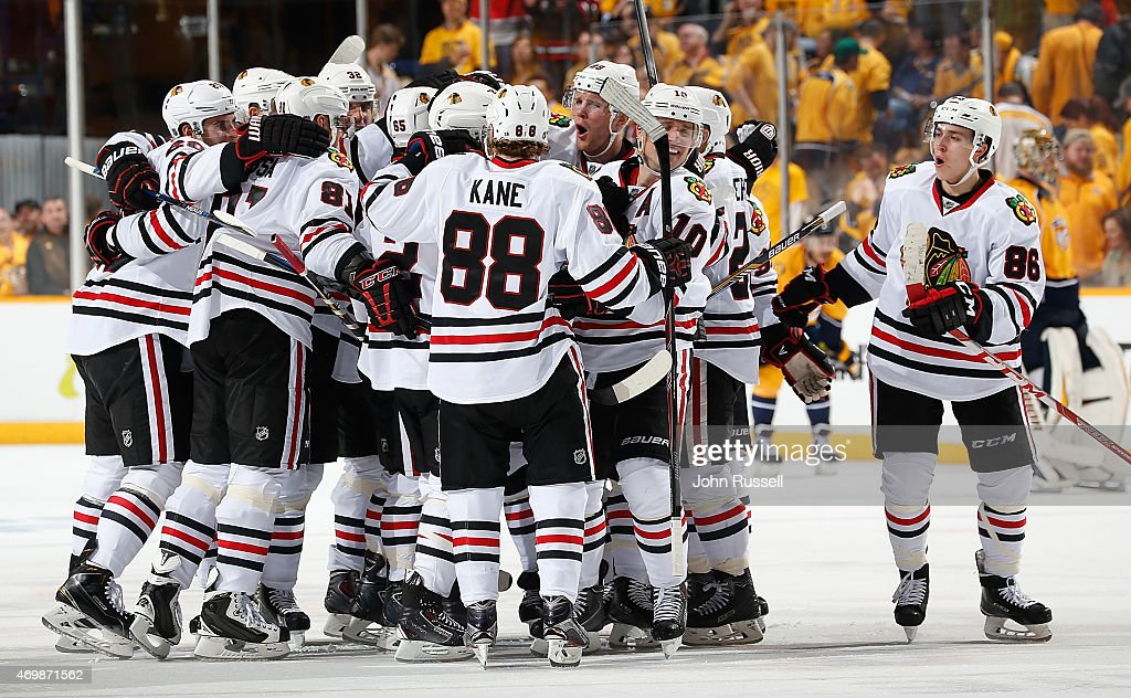 The Chicago Blackhawks celebrate a win against the Nashville Predators in the second overtime of Game One of the Western Conference Quarterfinals during the 2015 NHL Stanley Cup Playoffs at Bridgestone Arena on April 15, 2015 in Nashville, Tennessee.