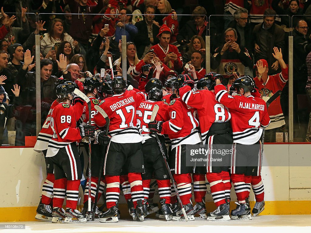The Chicago Blackhawks celebrate a win over the Columbus Blue Jackets at the United Center on March 1, 2013 in Chicago, Illinois. The Blackhawks defeated the Blue Jackets 4-3 in overtime.