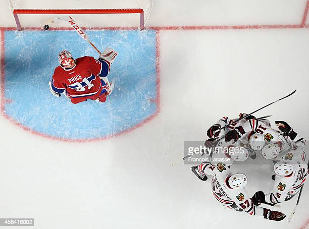 The Chicago Blackhawks celebrate after a goal scored on the third period of the game against the Montreal Canadiens in the NHL at the Bell Centre on...