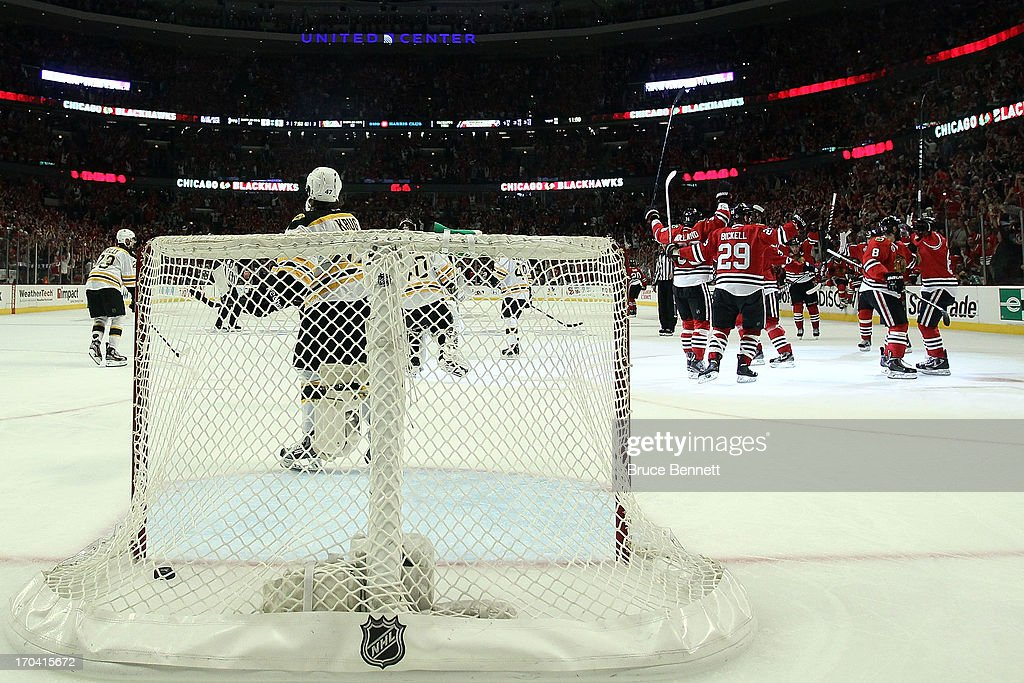 The Chicago Blackhawks celebrate after Andrew Shaw #65 scored the game-winnning goal in the third overtime against the Boston Bruins in Game One of the 2013 NHL Stanley Cup Final at United Center on June 12, 2013 in Chicago, Illinois.