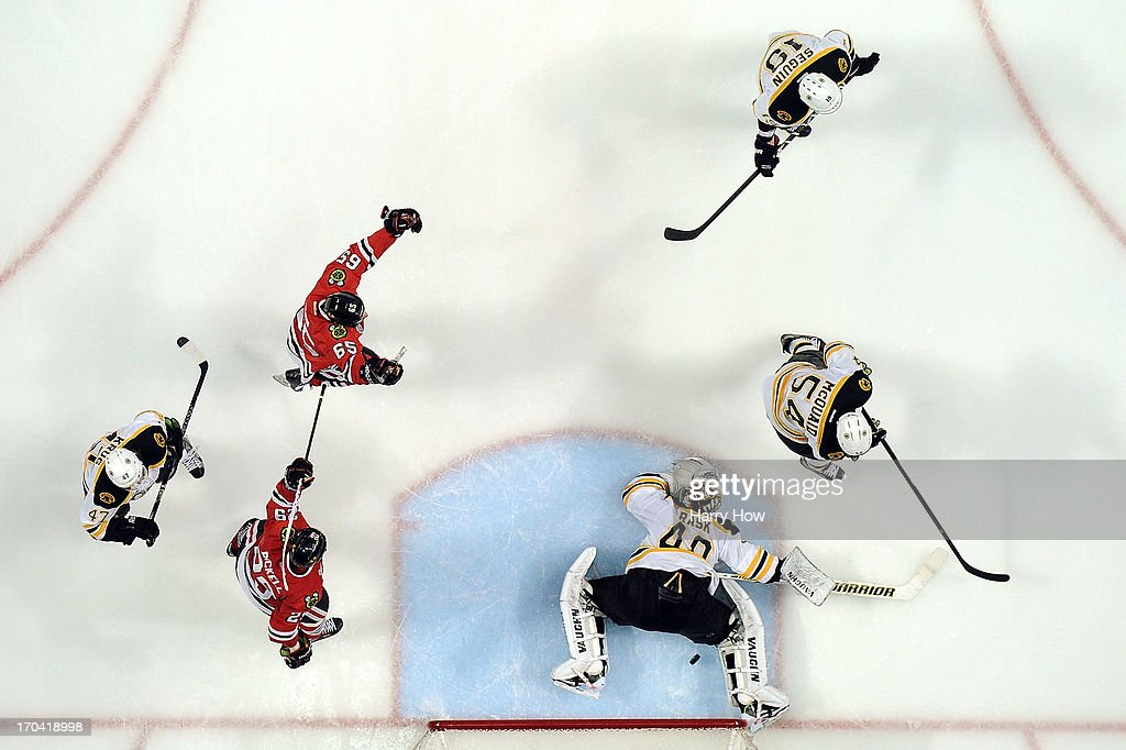 The Chicago Blackhawks celebrate after Dave Bolland #36 scored a goal in the third period against goalie Tuukka Rask #40 of the Boston Bruins in Game One of the 2013 NHL Stanley Cup Final at United Center on June 12, 2013 in Chicago, Illinois.