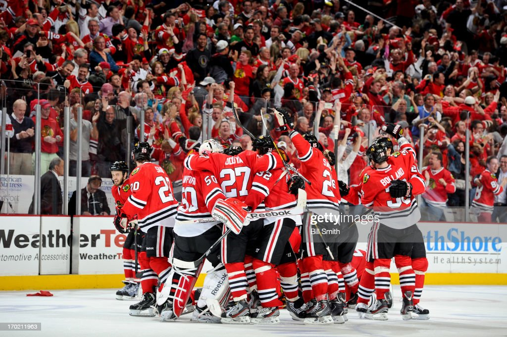 The Chicago Blackhawks celebrate after defeating the Los Angeles Kings and taking the Western Conference title in Game Five of the Western Conference Final during the 2013 Stanley Cup Playoffs at the United Center on June 08, 2013 in Chicago, Illinois.