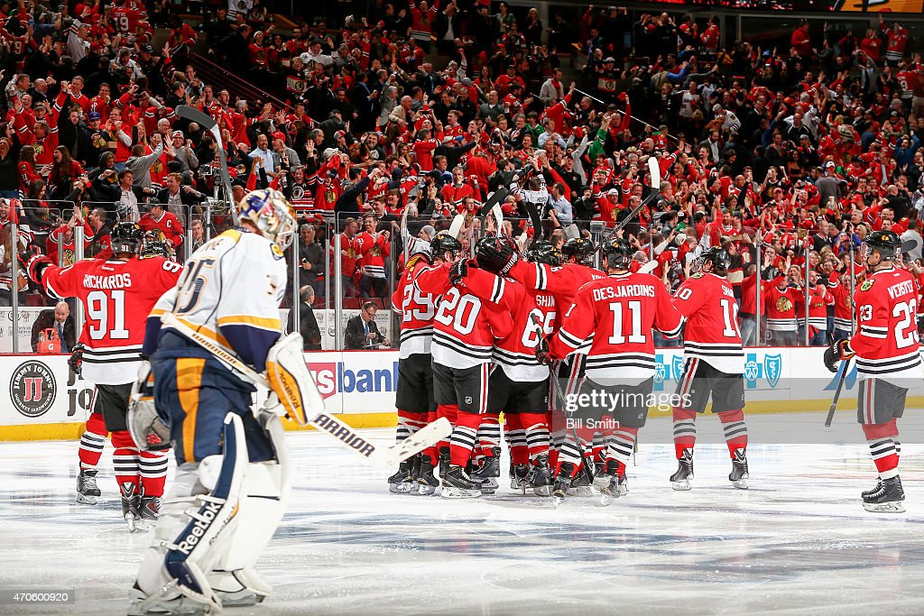 The Chicago Blackhawks celebrate after defeating the Nashville Predators 3-2 in the third overtime during Game Four of the Western Conference Quarterfinals during the 2015 NHL Stanley Cup Playoffs at the United Center on April 21, 2015 in Chicago, Illinois.
