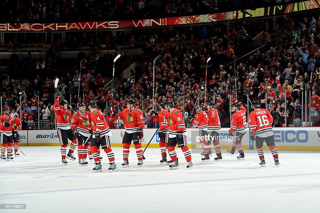 The Chicago Blackhawks celebrate after defeating the San Jose Sharks during the NHL game on February 15, 2013 at the United Center in Chicago, Illinois.