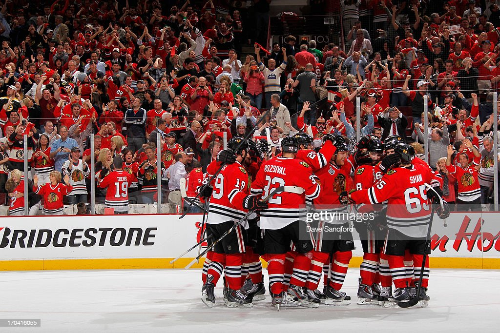 The Chicago Blackhawks celebrate after teammate Andrew Shaw #65 scored the game-winning goal during the third overtime of Game One of the 2013 Stanley Cup Final to beat the Boston Bruins 4-3 at the United Center on June 12, 2013 in Chicago, Illinois.