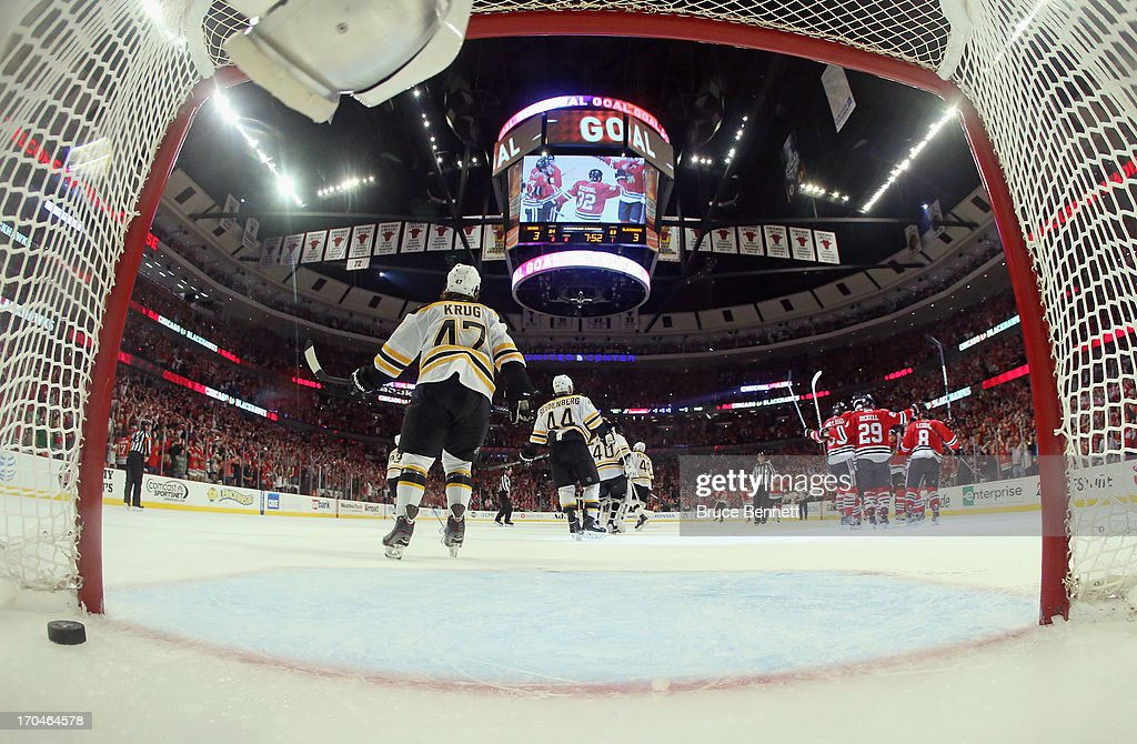The Chicago Blackhawks celebrate after their game-winning goal in the third overtime against goalie Tuukka Rask #40 of the Boston Bruins to give the Blackhawks a 4-3 win in Game One of the NHL 2013 Stanley Cup Final at United Center on June 12, 2013 in Chicago, Illinois.