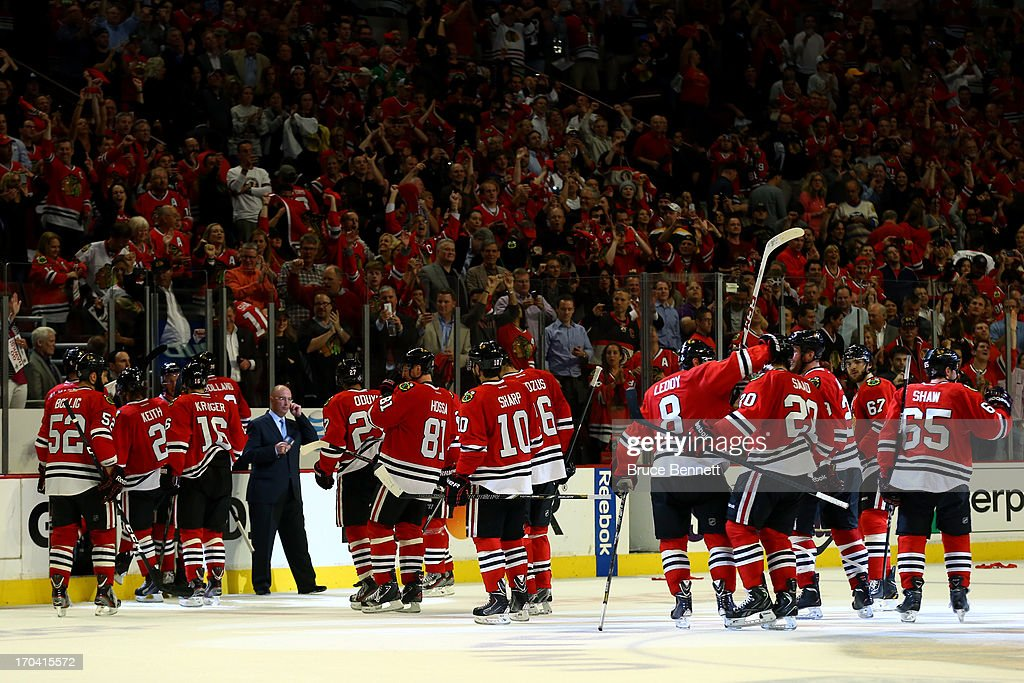 The Chicago Blackhawks celebrate after they won 4-3 in the third overtime against the Boston Bruins in Game One of the NHL 2013 Stanley Cup Final at United Center on June 12, 2013 in Chicago, Illinois.