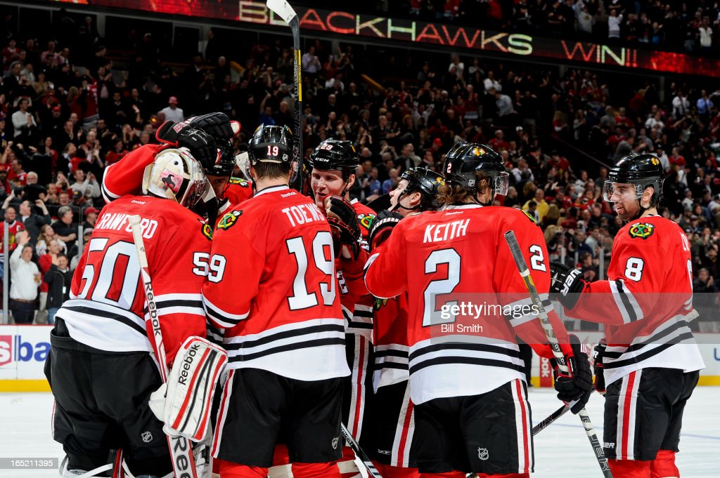 The Chicago Blackhawks celebrate, including <a gi-track='captionPersonalityLinkClicked' href=/galleries/search?phrase=Bryan+Bickell&family=editorial&specificpeople=241498 ng-click='$event.stopPropagation()'>Bryan Bickell</a> #29 and <a gi-track='captionPersonalityLinkClicked' href=/galleries/search?phrase=Nick+Leddy&family=editorial&specificpeople=5894600 ng-click='$event.stopPropagation()'>Nick Leddy</a> #8, after they defeated the Nashville Predators 3-2 during the NHL game on April 01, 2013 at the United Center in Chicago, Illinois.