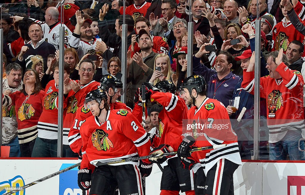 The Chicago Blackhawks celebrate, including <a gi-track='captionPersonalityLinkClicked' href=/galleries/search?phrase=Duncan+Keith&family=editorial&specificpeople=4194433 ng-click='$event.stopPropagation()'>Duncan Keith</a> #2, <a gi-track='captionPersonalityLinkClicked' href=/galleries/search?phrase=Jonathan+Toews&family=editorial&specificpeople=537799 ng-click='$event.stopPropagation()'>Jonathan Toews</a> #19, <a gi-track='captionPersonalityLinkClicked' href=/galleries/search?phrase=Michael+Frolik&family=editorial&specificpeople=537965 ng-click='$event.stopPropagation()'>Michael Frolik</a> #67, and <a gi-track='captionPersonalityLinkClicked' href=/galleries/search?phrase=Brent+Seabrook&family=editorial&specificpeople=638862 ng-click='$event.stopPropagation()'>Brent Seabrook</a> #7, after Frolik scored against the Los Angeles Kings during the NHL game on March 25, 2013 at the United Center in Chicago, Illinois.