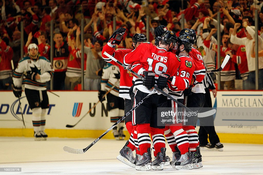 The Chicago Blackhawks celebrate the third period goal by Dave Bolland #36 as <a gi-track='captionPersonalityLinkClicked' href=/galleries/search?phrase=Dany+Heatley&family=editorial&specificpeople=202142 ng-click='$event.stopPropagation()'>Dany Heatley</a> #15 of the San Jose Sharks reacts in Game Three of the Western Conference Finals during the 2010 NHL Stanley Cup Playoffs at the United Center on May 21, 2010 in Chicago, Illinois.