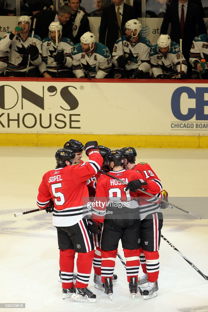 The Chicago Blackhawks celebrate the third period goal by Dave Bolland #36 as the San Jose Sharks bench reacts in Game Three of the Western Conference Finals during the 2010 NHL Stanley Cup Playoffs at the United Center on May 21, 2010 in Chicago, Illinois.