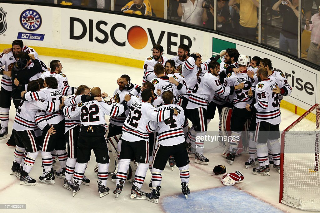 The Chicago Blackhawks celebrate the win over the Boston Bruins in Game Six of the 2013 NHL Stanley Cup Final at TD Garden on June 24, 2013 in Boston, Massachusetts.