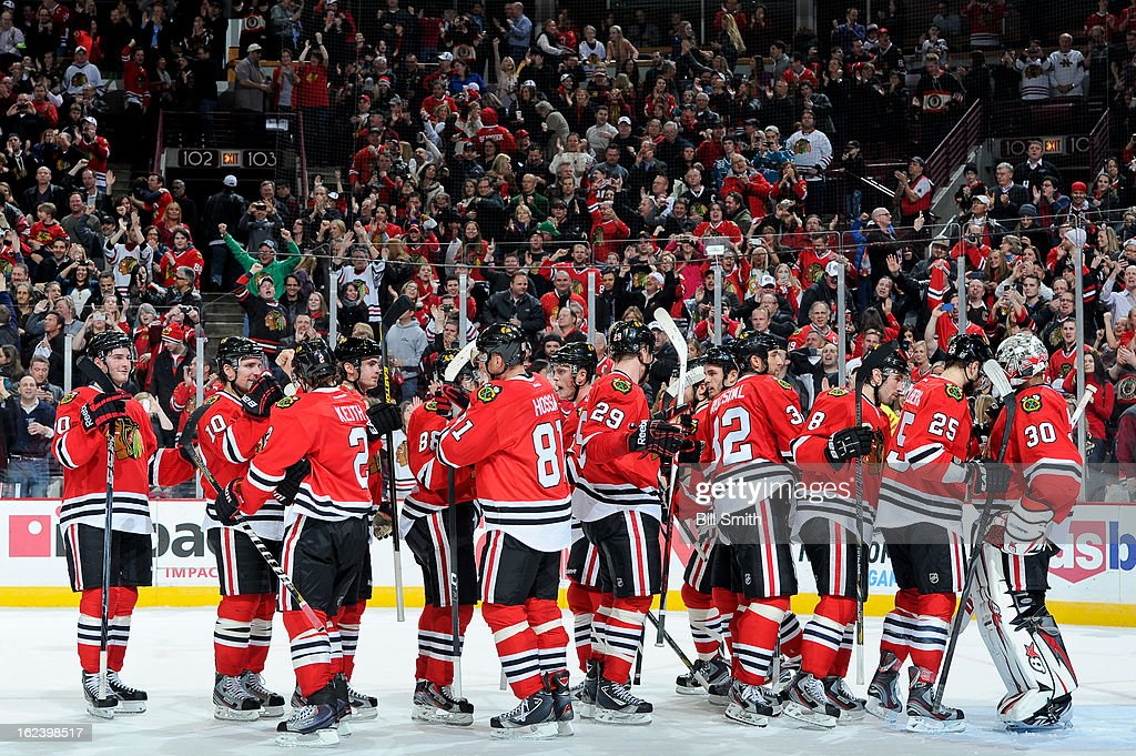 The Chicago Blackhawks celebrate their win over the San Jose Sharks after the NHL game on February 22, 2013 at the United Center in Chicago, Illinois.
