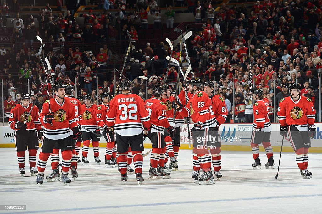The Chicago Blackhawks celebrate their win over the St. Louis Blues during the NHL game on January 22, 2013 at the United Center in Chicago, Illinois.