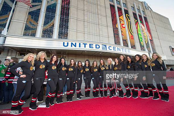 The Chicago Blackhawks Ice Crew pose for a photo prior to the NHL game against the Buffalo Sabres on October 11 2014 in Chicago Illinois