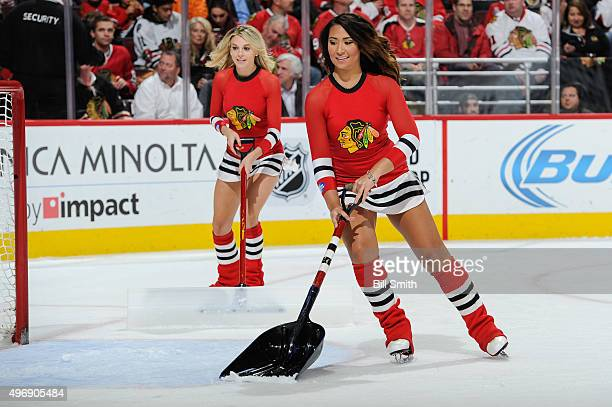 The Chicago Blackhawks icecrew scrape the ice during the NHL game between the Chicago Blackhawks and the New Jersey Devils at the United Center on...