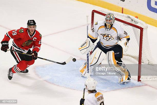 The Chicago Blackhawks' Jonathan Toews eyes the puck in front of the net of Nashville Predators goalie Carter Hutton during the second period at the...