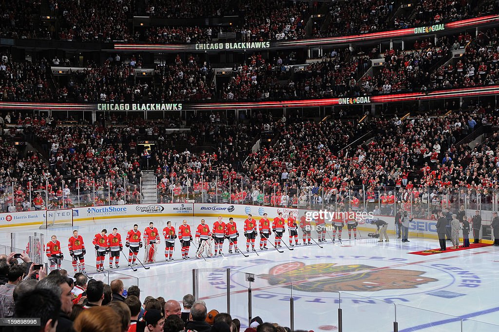 The Chicago Blackhawks line up for the 'Star Spangled Banner' before NHL game against the St. Louis Blues on January 22, 2013 at the United Center in Chicago, Illinois.