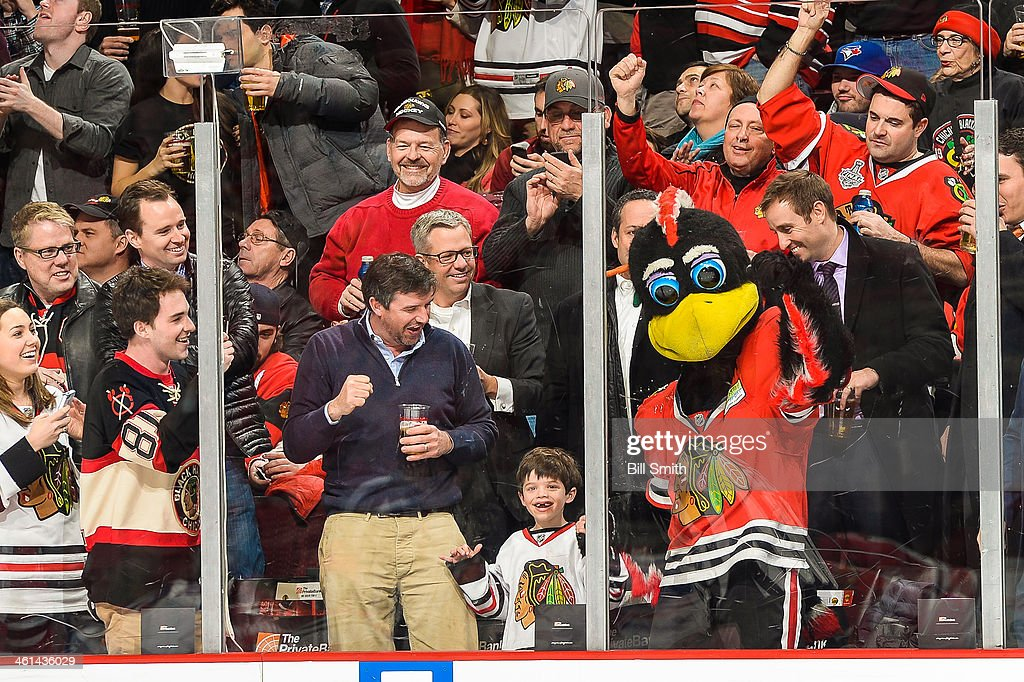 The Chicago Blackhawks mascot Tommy Hawk cheers with fans after the Blackhawks scored against the New York Rangers during the NHL game on January 08, 2014 at the United Center in Chicago, Illinois.