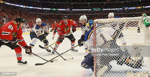 The Chicago Blackhawks' Patrick Kane tries to score against St Louis Blues goaltender Brian Elliott while being defended by Blues defensemen Alex...