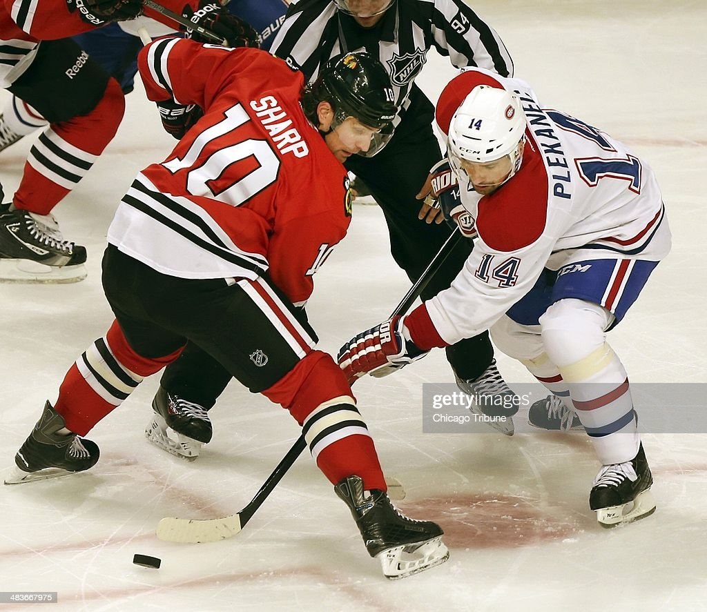 The Chicago Blackhawks' Patrick Sharp (10) and the Montreal Canadiens' Tomas Plekanec (14) face off in the second period at the United Center in Chicago on Wednesday, April 9, 2014.