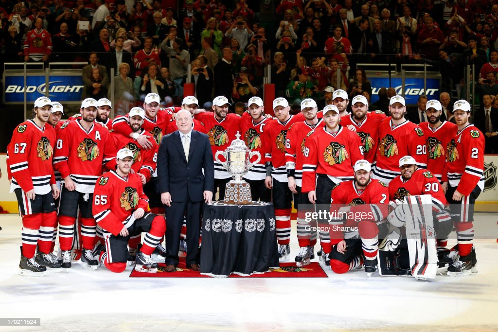 The Chicago Blackhawks pose for a team photo with the Clarence S. Campbell Bowl after they won 4-3 in the second overtime against the Los Angeles Kings during Game Five of the Western Conference Finals of the 2013 NHL Stanley Cup Playoffs at United Center on June 8, 2013 in Chicago, Illinois.