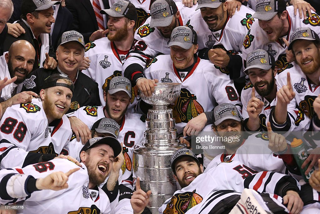 The Chicago Blackhawks pose with the Stanley Cup Trophy after defeating the Boston Bruins in Game Six of the 2013 NHL Stanley Cup Final at TD Garden on June 24, 2013 in Boston, Massachusetts. The Chicago Blackhawks defeated the Boston Bruins 3-2.