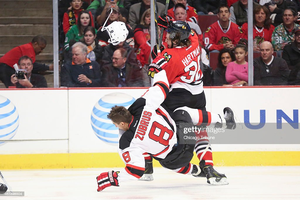 The Chicago Blackhawks' <a gi-track='captionPersonalityLinkClicked' href=/galleries/search?phrase=Ryan+Hartman&family=editorial&specificpeople=9156569 ng-click='$event.stopPropagation()'>Ryan Hartman</a> (38) checks the New Jersey Devils' <a gi-track='captionPersonalityLinkClicked' href=/galleries/search?phrase=Dainius+Zubrus&family=editorial&specificpeople=204779 ng-click='$event.stopPropagation()'>Dainius Zubrus</a> (8) during the first period at the United Center in Chicago on Friday, Feb. 13, 2015. The Blackhawks won, 3-1.