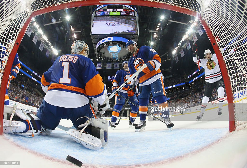 The Chicago Blackhawks scores against Thomas Greiss #1 of the New York Islanders at the Barclays Center on October 9, 2015 in Brooklyn borough of New York City. The game is the first for the Islanders in their new arena. The Blackhawks defeated the Islanders 3-2 in overtime.
