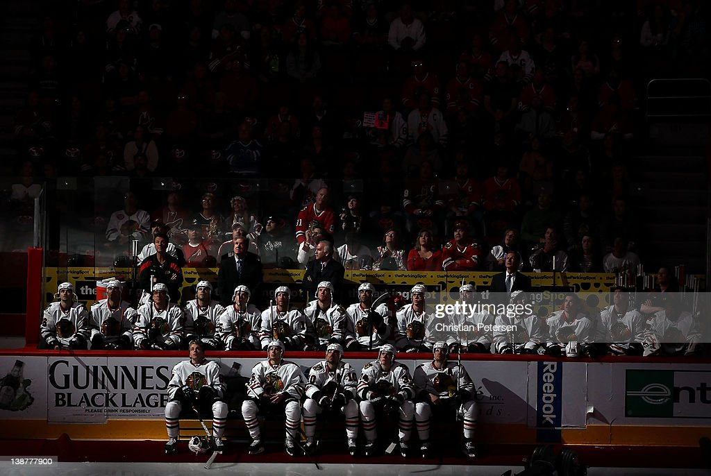 The Chicago Blackhawks sit on the bench and watch the pregame ceremony before the NHL game against the Phoenix Coyotes at Jobing.com Arena on February 11, 2012 in Glendale, Arizona. The Coyotes defeated the Blackhawks 3-0.